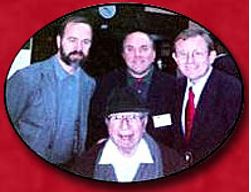 Dr. Mortimer Adler [sitting] at his last Great Books Discussion Group, (2000 A.D.), with the initial online Great Books Program directors [standing, left to right] Steve Bertucci, Pat Carmack (the author), and Tom Orr